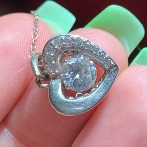 Moving heart necklace
